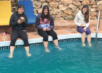 Some of the girls, not brave enough for the pool dip their toes